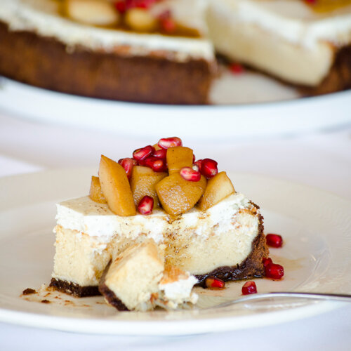 Cheese cake with goat´s milk cheese, poached pears and pomegranate seeds